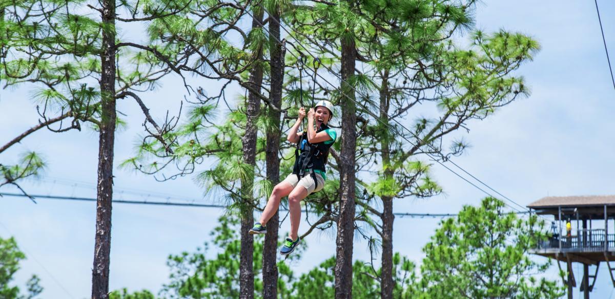 Woman ziplining in Kissimmee Florida