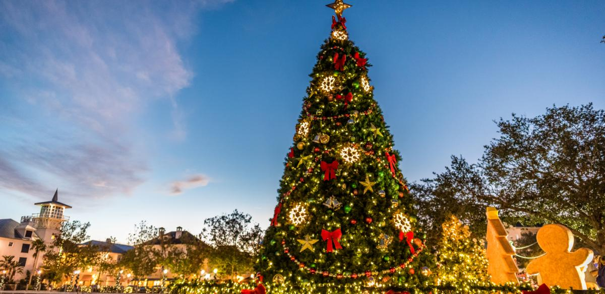 An outdoor holiday tree fully decorated on a beautiful Kissimmee day