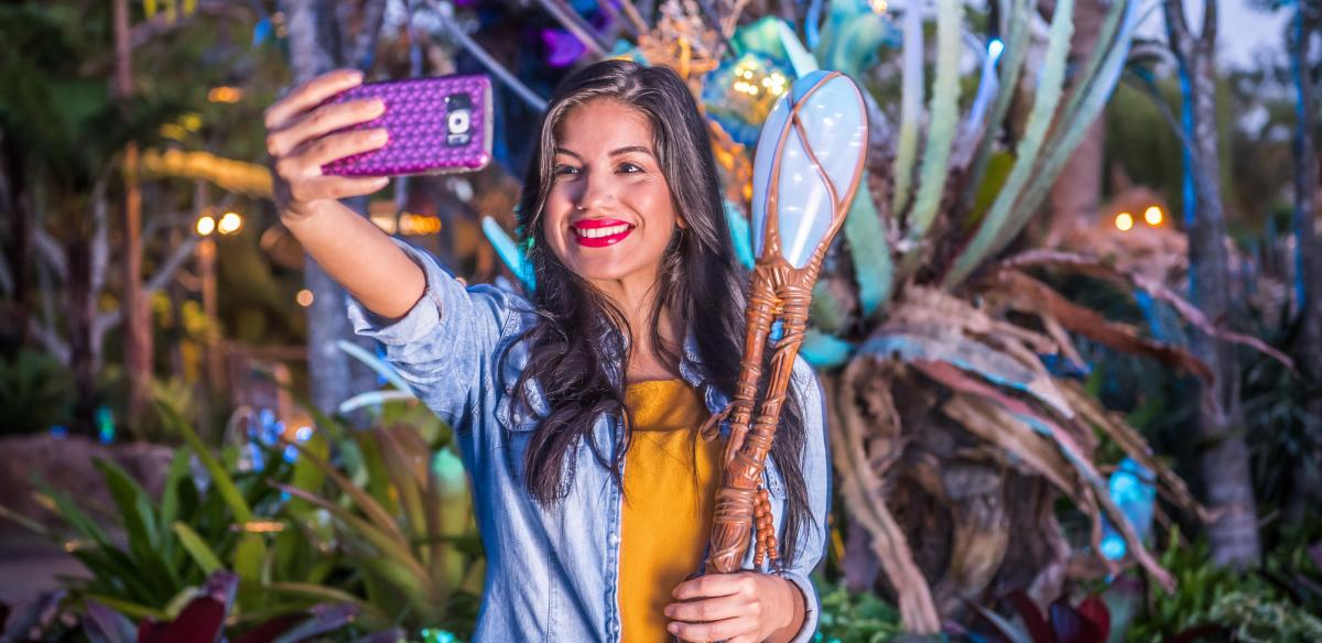 A girl taking a selfie in Disney World