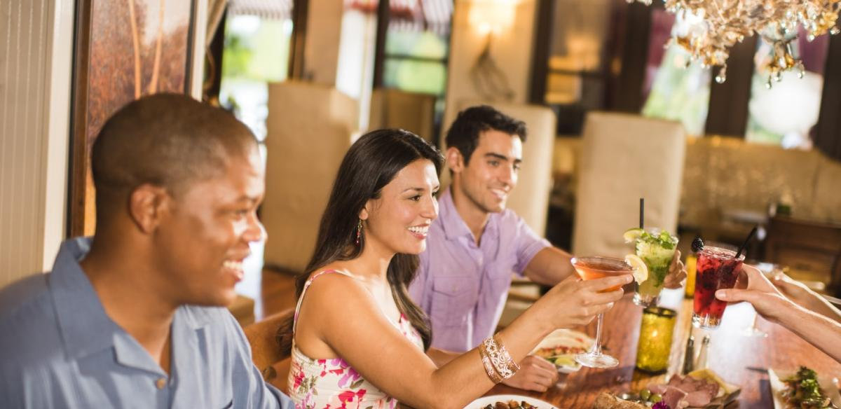 Friends and family toast to a meal in Kissimmee