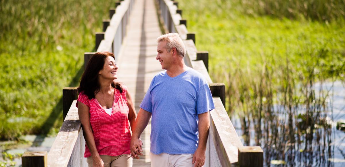 A local couple walks a boardwalk near Kissimmee Florida
