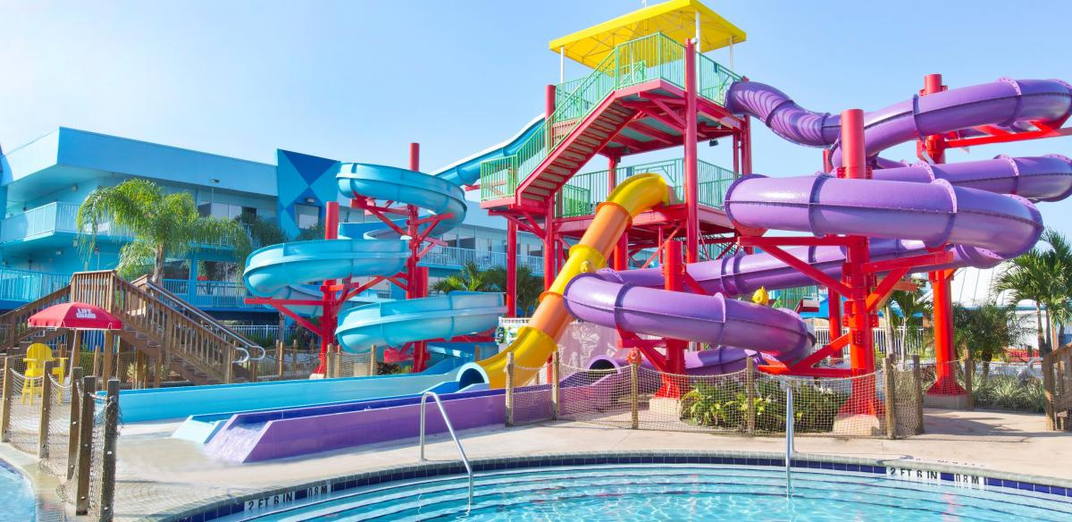 A purple, blue, yellow, and orange waterslide on a sunny day in Kissimmee, Florida.