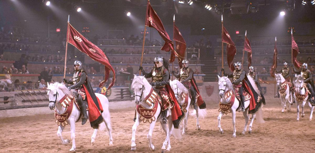Knights charging into the arena at Medieval Times Dinner and Tournament