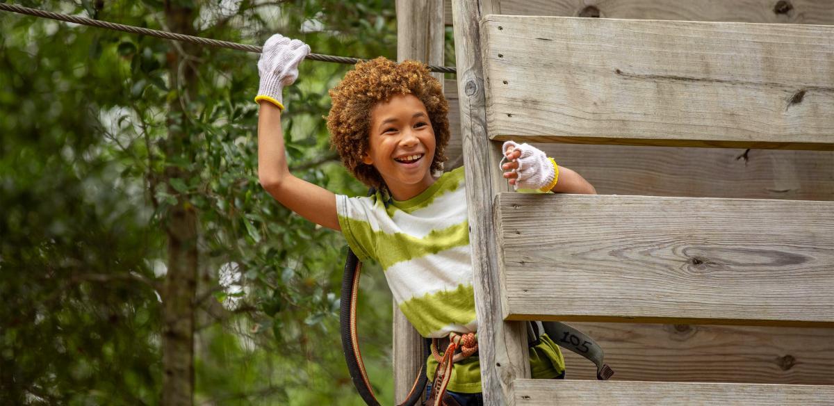 A child on the zipline at Orlando Tree Trek Adventure
